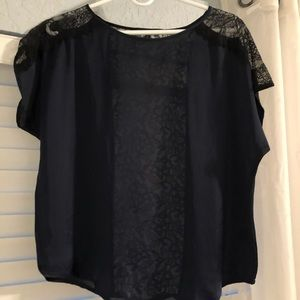 Navy blue shirt with lace sleeves and back
